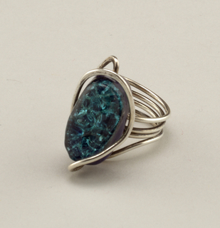 Silver coiled ring with silver encircling a glass oval that is turquoise colored and crackled; it is set in earthenware and enamel.