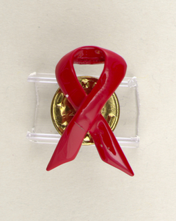 In form of red looped ribbon.