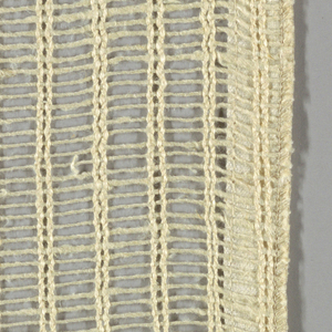Gauze weave in off-white. Pairs of warp threads give vertical stripe effect.