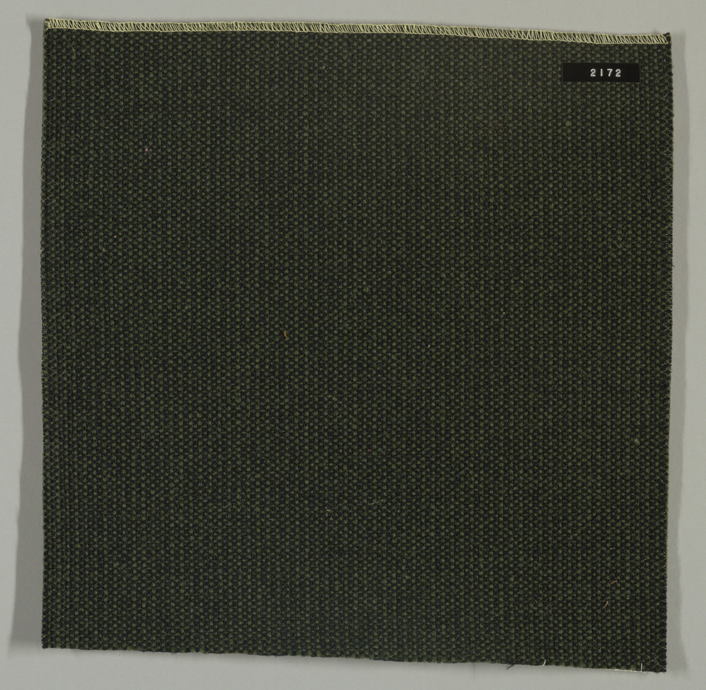 Coarse plain weave in olive green and black.