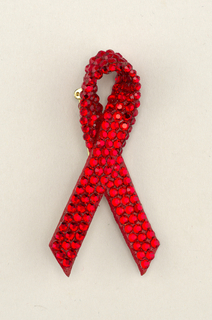 In the form of a looped red ribbon symbolizng AIDS awareness.