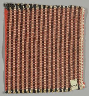 Vertically striped plain weave in orange, black, light brown and white. Warp threads are black, light brown and white. Weft threads are orange.