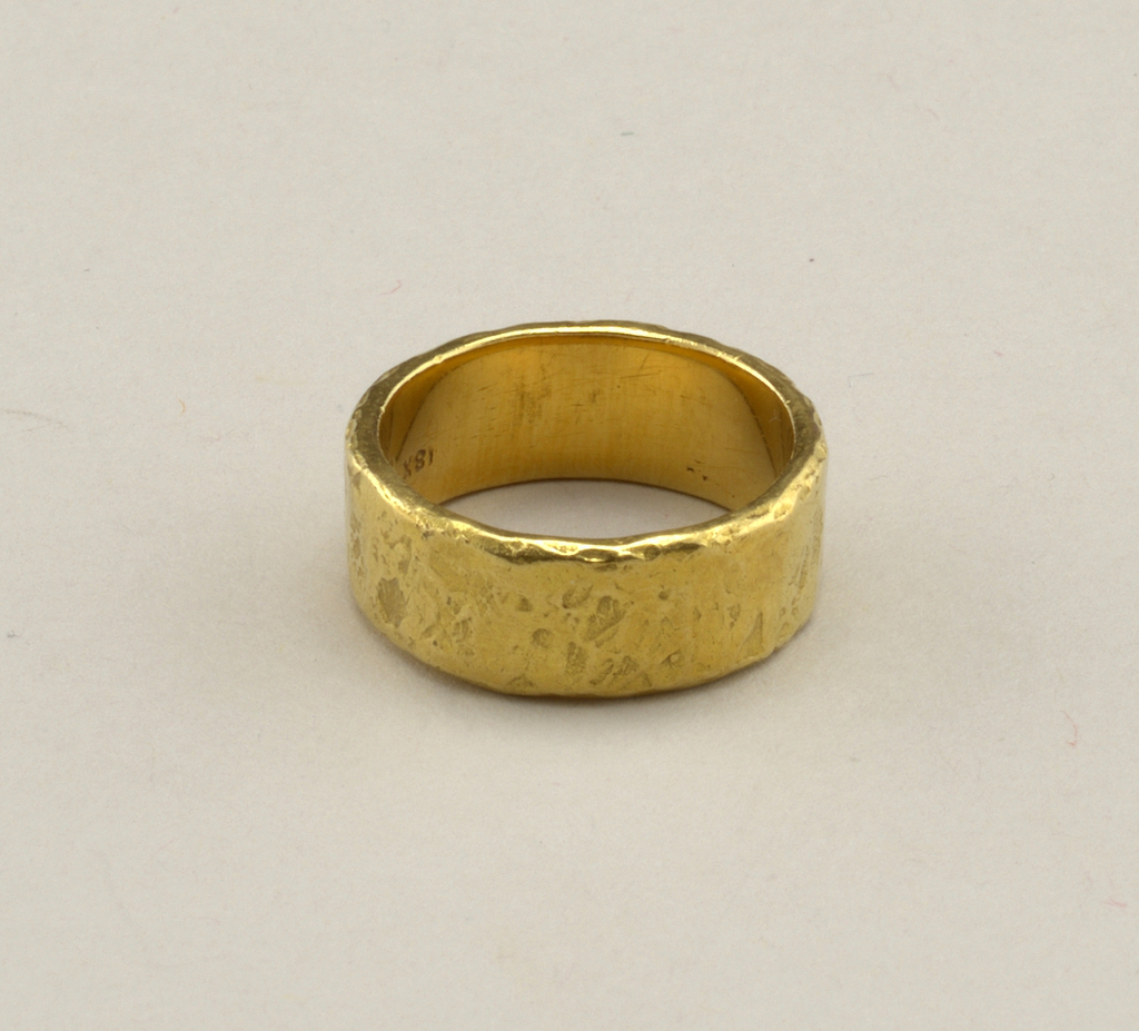 Hammered gold band.