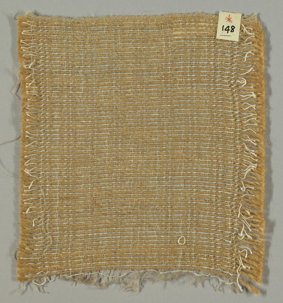 Plain weave in tan, brown and white. Warp is comprised of fine brown threads, and the weft is comprised of heavy jute yarns and fine white threads.