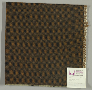 Coarse plain weave with black warp and brown weft.