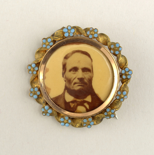 Circular; portrait of a bearded man, gilded metal frame with blue-enameled forget-me-nots.