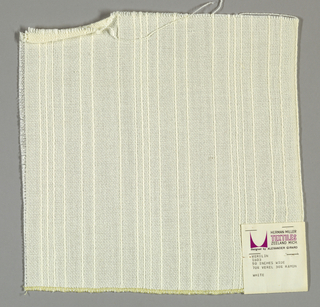 Plain weave in white. Warp yarns are white with some substantially heavier yarns. This gives a vertical stripe effect. Weft is comprised of white yarns of the same weight.
