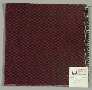 Coarse plain weave with dark red warp and black weft.
