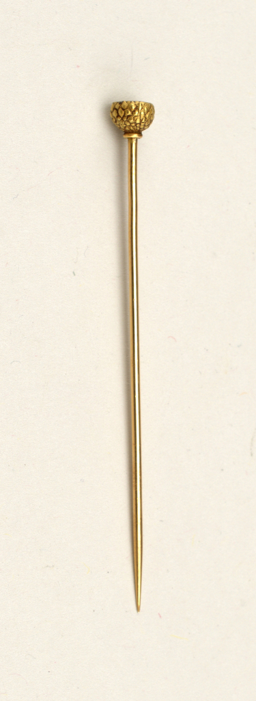 Metal stick pin of curved foliage cradling profile of butterfly with colored wing and opalescent stone at bottom.