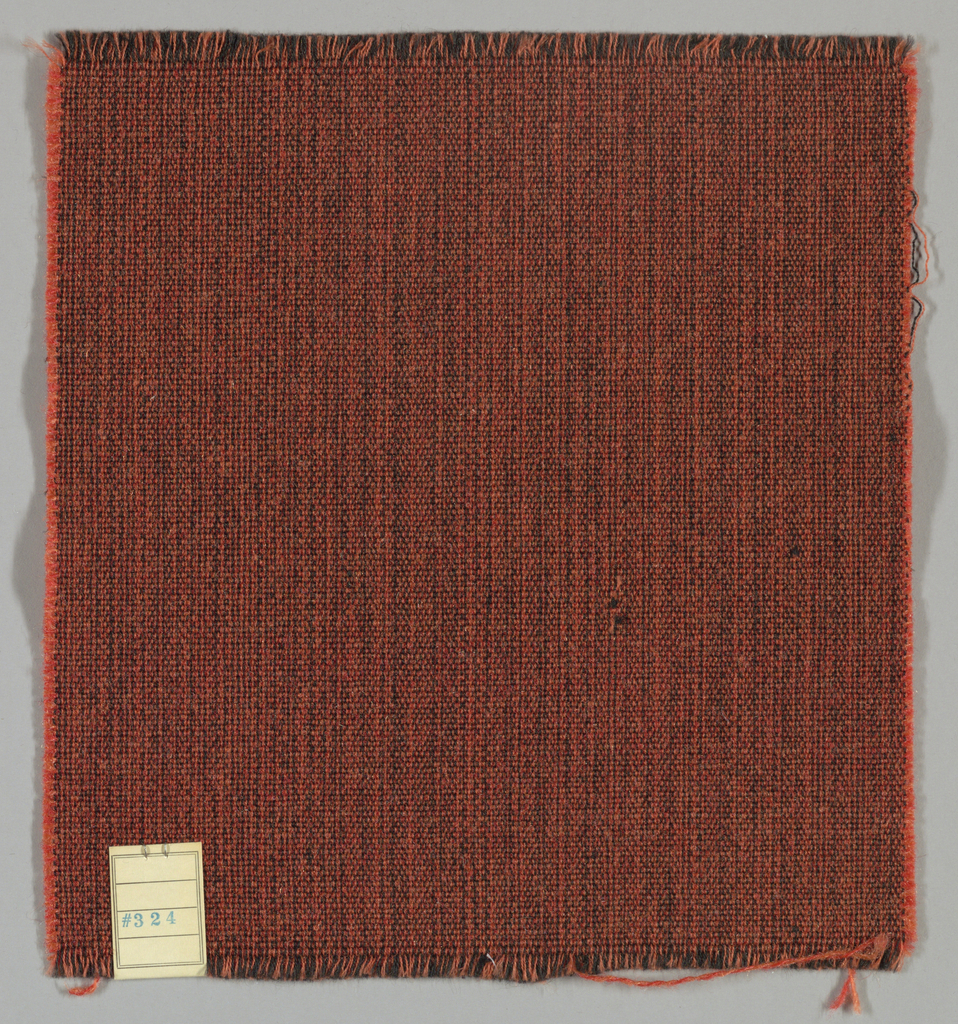 Plain weave with doubled warps and wefts in black, light crimson, and crimson. Warps are black and light crimson while the wefts are crimson and light crimson. Number 324.
