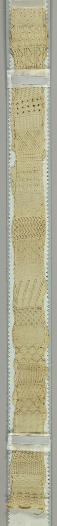 Very long narrow sampler of forty-seven knitted patterns in white cotton.