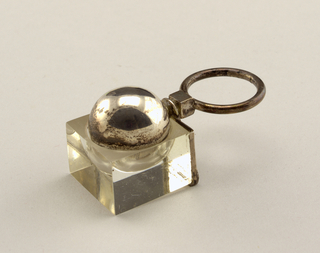 Thin circular silver band, plexi cube with silver sphere