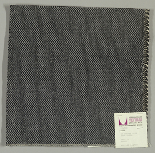 Coarse plain weave with light grey warp and black weft.