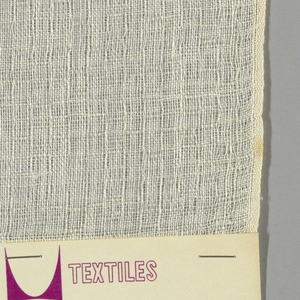 Plain weave in off-white. Open weave structure gives a gauze-like effect. Number 297.