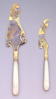 Undulating gilt blade decorated with flowers, geometric patterns, Japanese woman with fan.