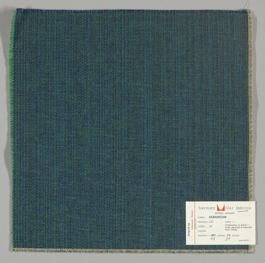 Plain weave with doubled warps and wefts in black, blue, green and dark green. Warps are black and blue while the wefts are green and dark green. Number 322.