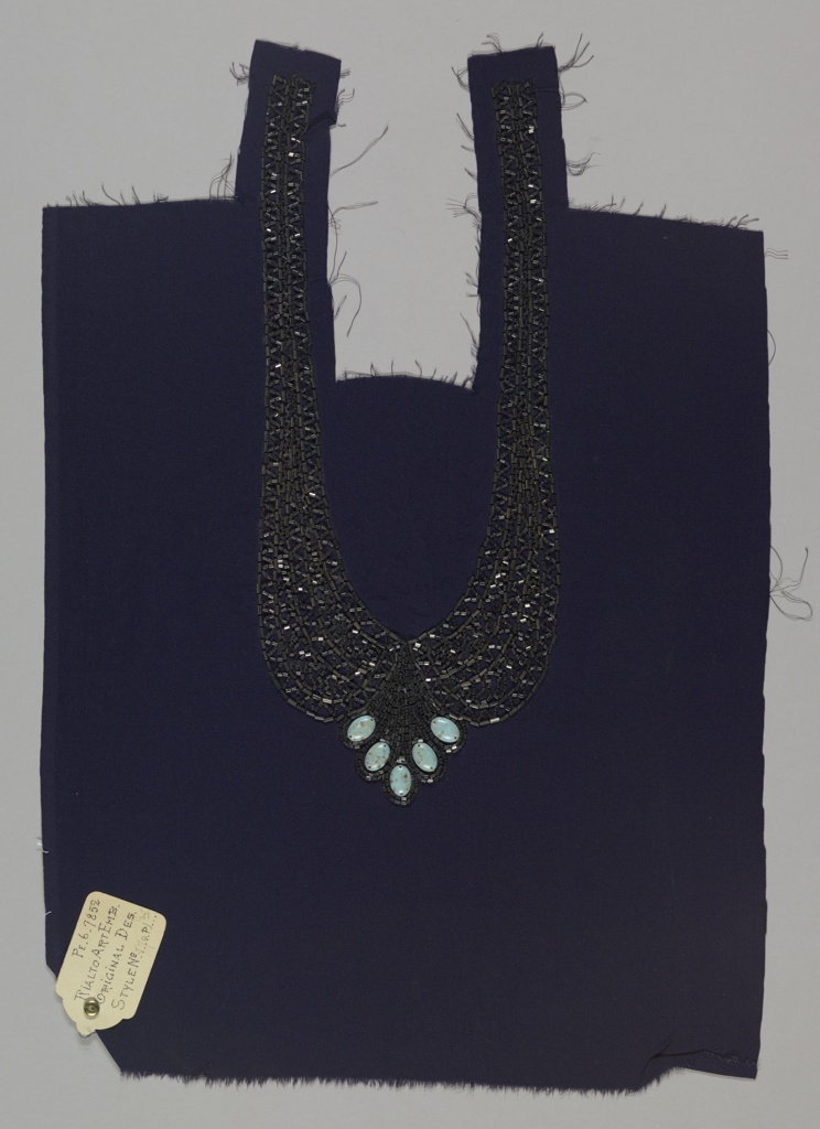 Panel for a dress front. Bib style, with festooned trompe l'oeil necklace, beaded with hematite bugle beads and faux turquoise cabochon gems, on navy blue crepe ground.