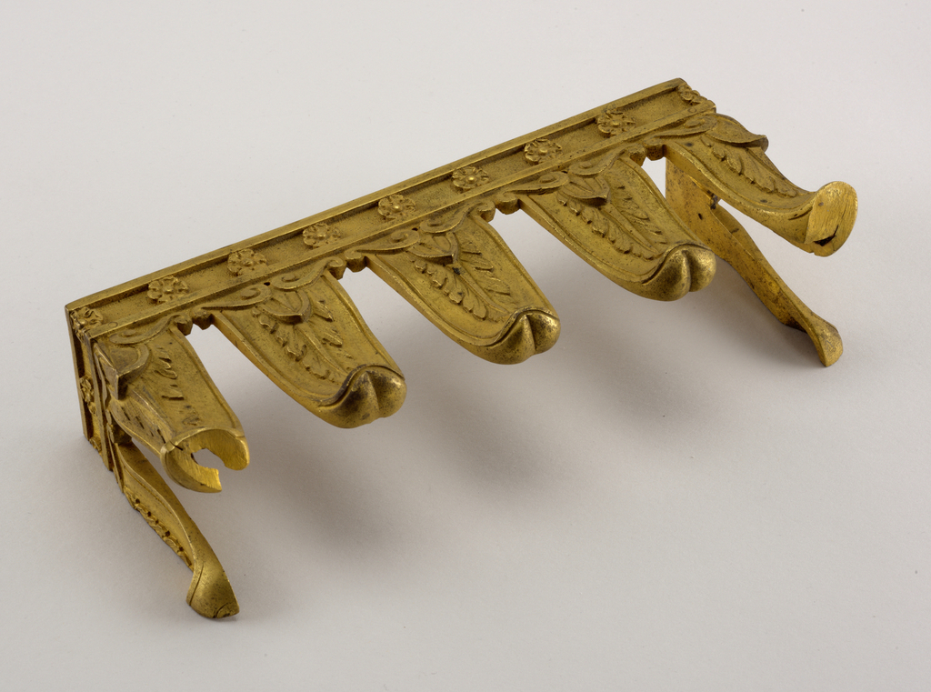 One of three matching bracket pilaster mounts.  Empire style with pendant tongues decorated with palmetto below a frieze of rosettes.