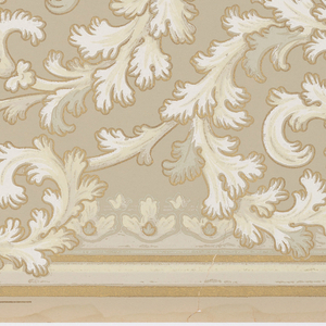 A repeating design of scrolling acanthus leaves of ivory and white bordered in gold upon a grey ground, the design bordered at the top and the bottom by bands of grey, white and gold.
