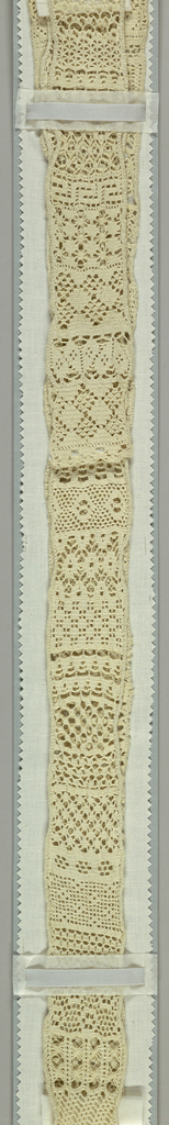 Very long narrown sampler of fifty-nine knitted patterns in white cotton