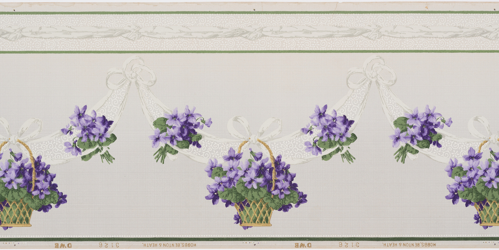 A repeating design of swags of grey ribbons with a floral design in white from which baskets of violets are hung with complementary bouquets of violets entwined in the ribbons. Printed on a grey ground with a white grid design below a grey ribbon between two bands of green, complementing the band below the sequence.