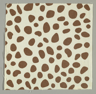 White plain weave printed with a random pattern of brown circles and ovals.