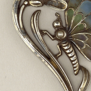 Curvilinear foliage with insect with plique-a-jour enamel wings, opal on stem.
