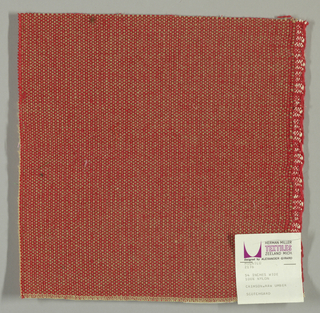 Coarse plain weave with beige warp and red weft.