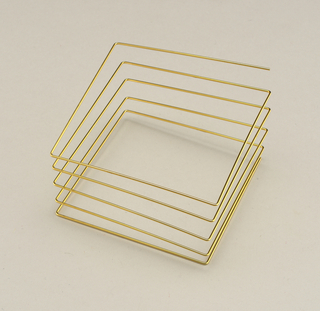 Square spiraled length of gold-plated steel.