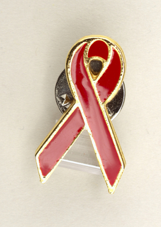 in form of red looped ribbon with gold edge.
