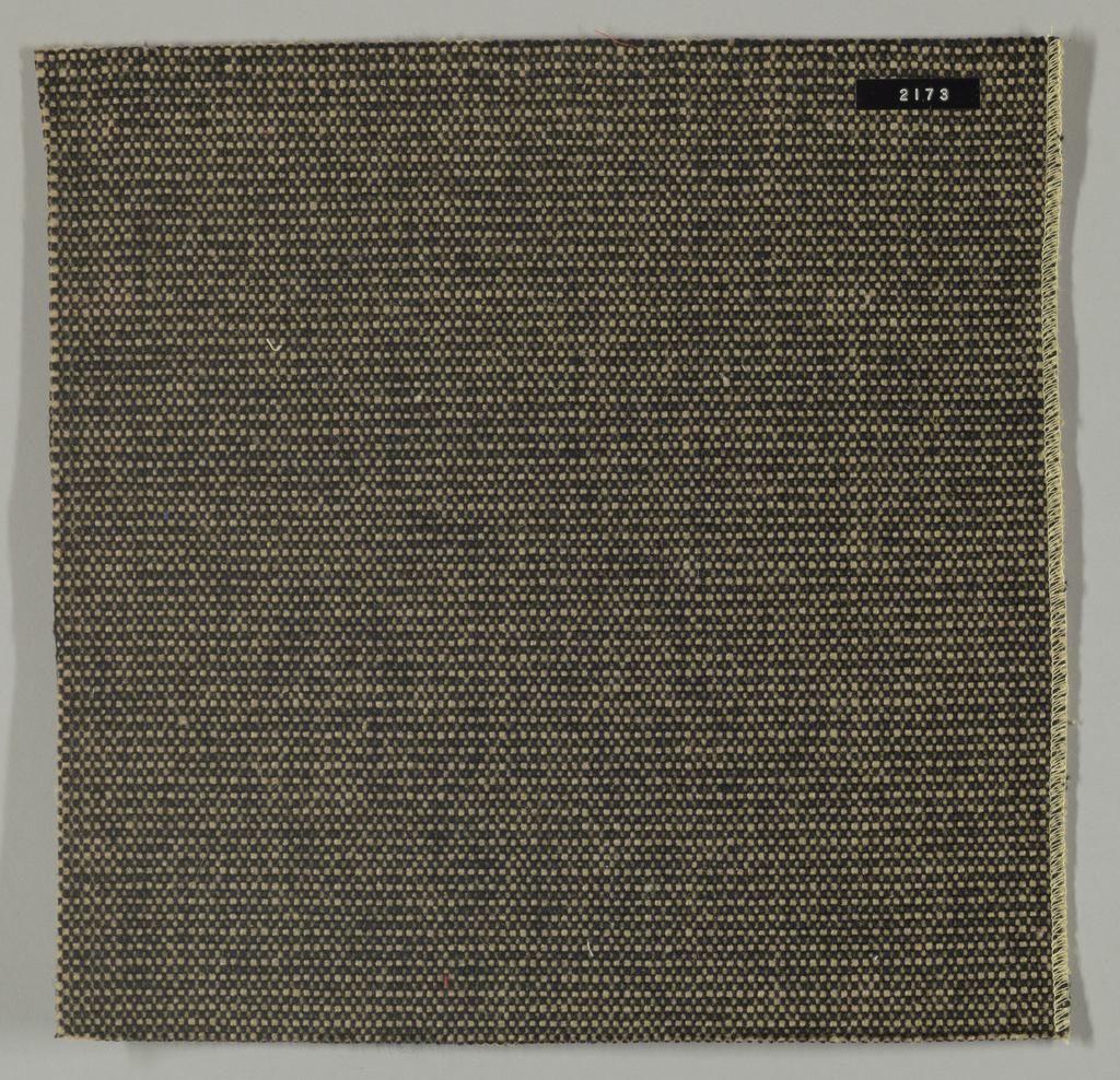 Coarse plain weave in beige and black.