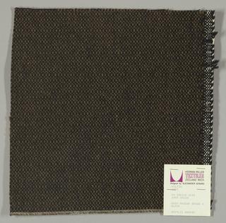 Coarse plain weave brown warp and black weft.
