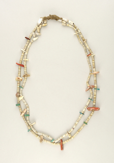 Necklace of two strands made of shell discs, whole shells, and larger pieces of turquoise and red stones strung on leather.