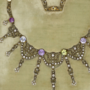 Gold and enamel links with eleven pendant ornaments, intersperced with eight fancy-colored sapphires, sixty diamonds, and thirty-three pearls.