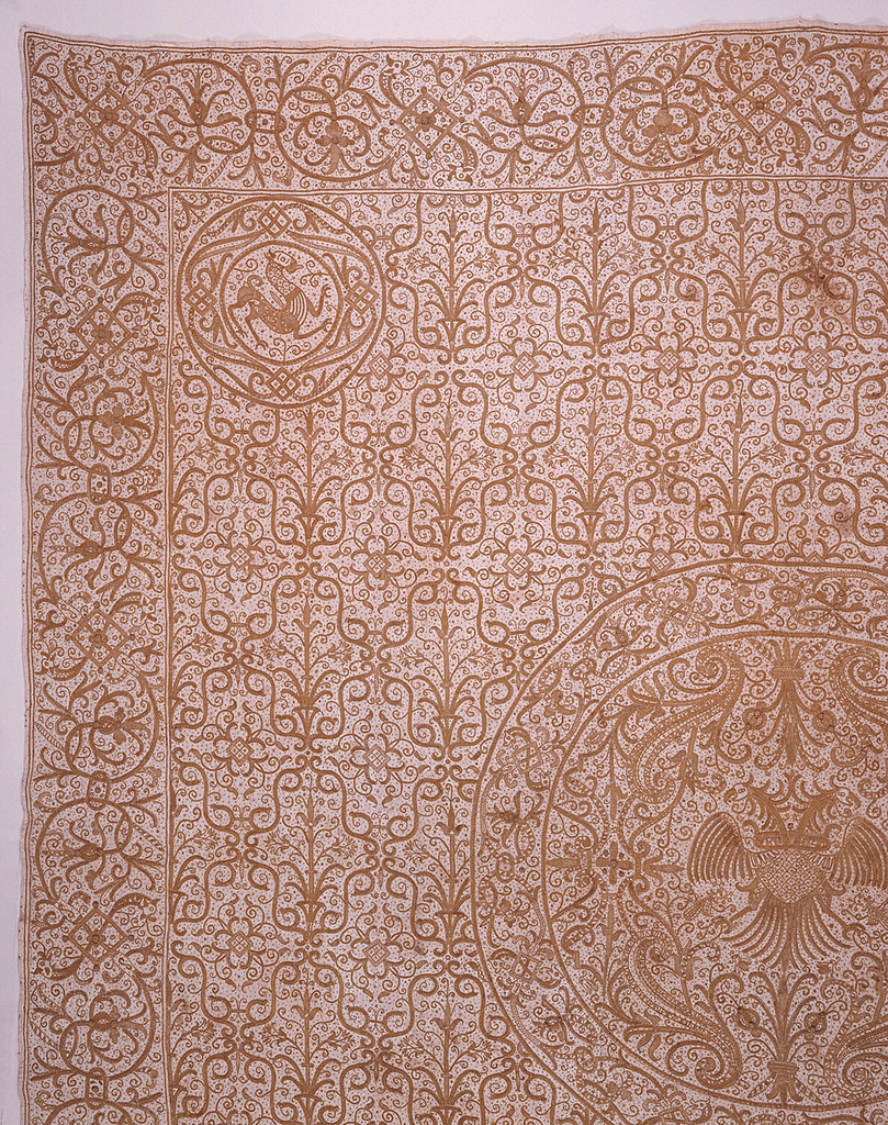A square bedcover with a wide border on all sides, a central medallion and smaller medallions in each corner, with an allover floral lattice ground. The central medallion contains a double-headed eagle and the corner medallions each contain a fantastic beast.  The outer borders are linked repeats of an S-shaped floral vine.  All executed in light gold color flax thread on an off-white ground.