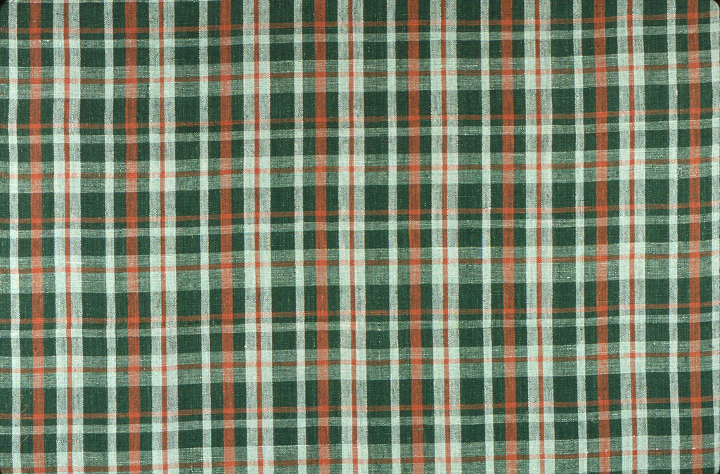 Plain woven linen with an uneven plaid of green, orange and white.