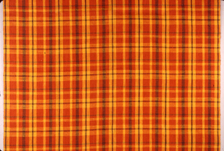 Plain woven linen with an uneven plaid in orange, yellow and brown.