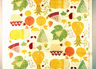 A pattern of stylized fruits (including pineapples, grapes, cherries, apples, lemons, strawberries, and oranges) and leaves printed in green, yellow/green, red, and orange.