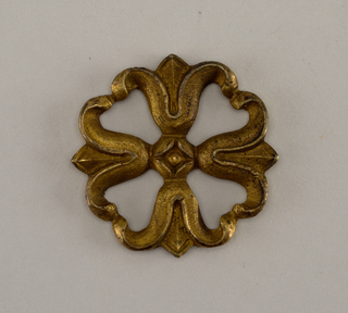 Furniture mount in the form of a pierced rosette, composed of lotus buds.