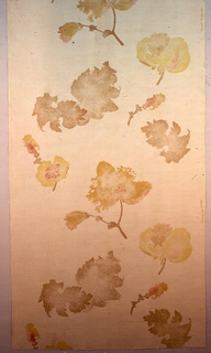 Large scattered leaves and flowers printed in brown, orange and gold color on tan fabric foundation fabric.