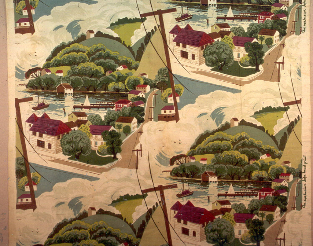 A repeated design of a northeast seacoast town with prominent telephone lines; printed in red, brown, greens and blues on white.
