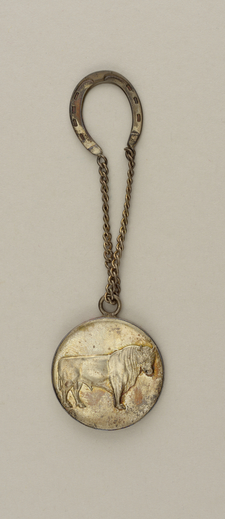 """Patina silver coin and chain with a depiction of a bull on the face; """"AW"""" intitials on verso and """"The Best is Yet to Come"""" inscribed."""