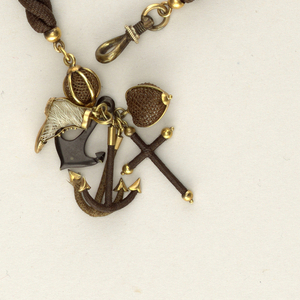 (a) Man's watch chain; cylinders of strands of hair set in gold alternating with globes of hair within gold cages; ornaments in the form of one cross, three anchors, one heart shape and one shoe. (b) Stud of gold with snake in gold coiled around a half-ball of brown human hair.