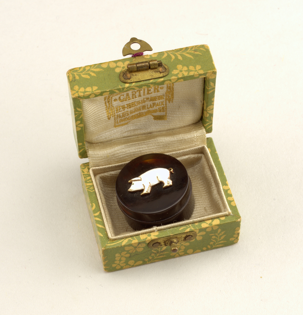 Circular box and cover with enamel image of a white pig in profile.