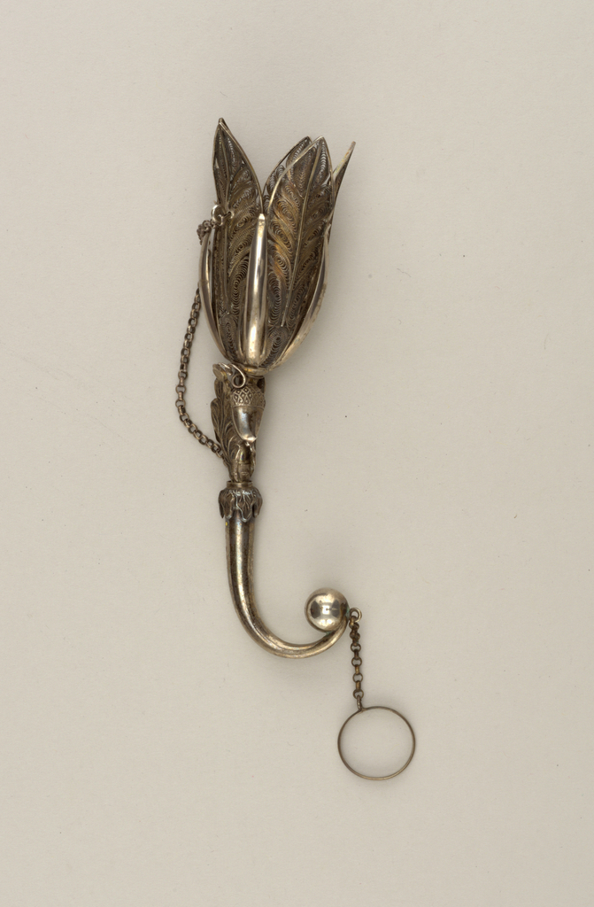 tapering tubular handle curving to a small ball, with chain and ring attached. Oak-leaf and acorn ornamentation at base of filigree.