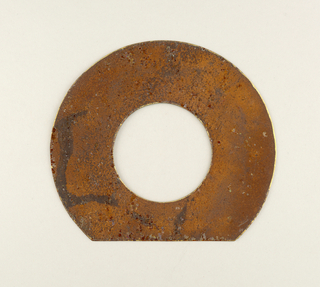 Bronze-colored patinated large disk ring shape.