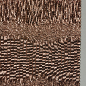 Four samples of embossed sheet metal with cotton backing. (a) copper, (b) silver, (c) gold, (d) grey