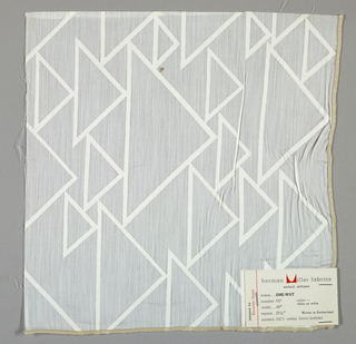 Sheer white plain weave printed with triangles in an outline pattern of white. Number 597.