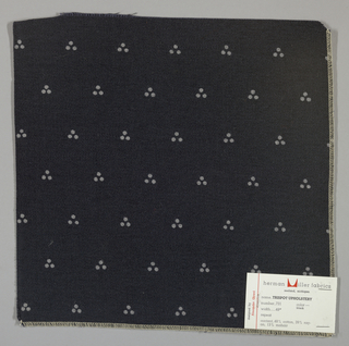 Weft-faced twill in black with a triple dot pattern produced by a discharge printing process. Number 731.