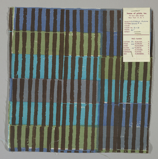 White plain weave hand printed with horizontal bands of turquoise, green, blue and grey intersected by vertical brown bars. Color no. 6g